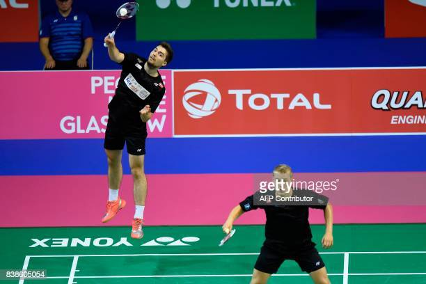 Denmark's Mathias Christiansen and David Daugaard return to Indonesia's Mohammad Ahsan and Rian Agung Saputro during their round three men's doubles...