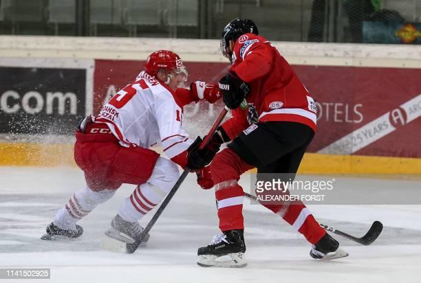 Denmark's Matias Lassen and Austria's Peter Schneider vie for the puck during the international Icehockey friendly match between Austria and Denmark...