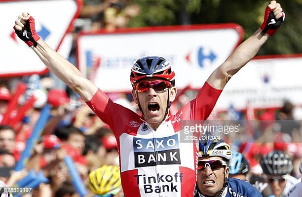 Denmark's Michael Morkov celebrates his victory on August 29 2013 at the end of the sixth stage of the 68th edition of 'La Vuelta' Tour of Spain a...