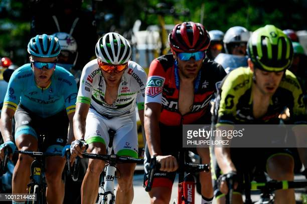 Denmark's Michael Valgren France's Warren Barguil Italy's Damiano Caruso and Spain's Mikel Nieve ride in the last ascent during their breakaway of...