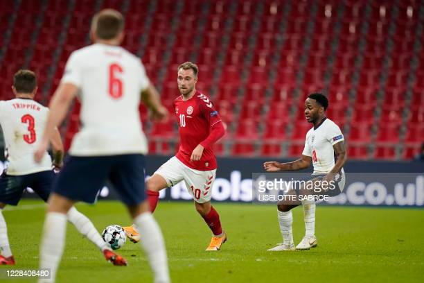 Denmark's midfielder Christian Eriksen and England's forward Raheem Sterling vie for the ball during the UEFA Nations League football match between...