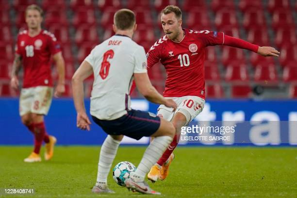 Denmark's midfielder Christian Eriksen and England's midfielder Eric Dier vie for the ball during the UEFA Nations League football match between...