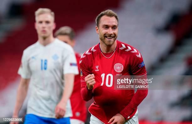 Denmark's midfielder Christian Eriksen celebrates after scoring the 1-0 during the UEFA Nations League football match Denmark vs Iceland on November...