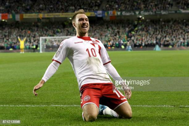 TOPSHOT Denmark's midfielder Christian Eriksen celebrates after scoring their third goal during the FIFA World Cup 2018 qualifying football match...