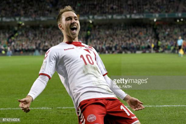 Denmark's midfielder Christian Eriksen celebrates after scoring their third goal during the FIFA World Cup 2018 qualifying football match second leg...