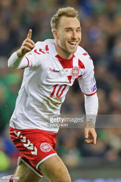Denmark's midfielder Christian Eriksen celebrates after scoring their third goal during the FIFA World Cup 2018 qualifying football match second leg...