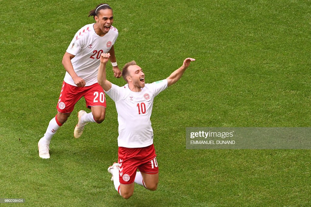 TOPSHOT - Denmark's midfielder Christian Eriksen (R) celebrates after socring the opening goal during the Russia 2018 World Cup Group C football match between Denmark and Australia at the Samara Arena in Samara on June 21, 2018. (Photo by EMMANUEL DUNAND / AFP) / RESTRICTED