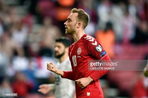 Denmark's midfielder Christian Eriksen celebrates scoring during the UEFA Euro 2020 qualifier Group D football match Denmark against Georgia on June...