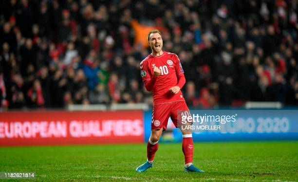 Denmark's midfielder Christian Eriksen celebrates scoring during the UEFA Euro 2020 Group J qualification football match between Denmark and...