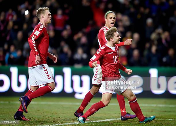 Denmark's midfielder Christian Eriksen celebrates scoring the 21 goal with his teammate during the World Cup 2018 qualification football match...