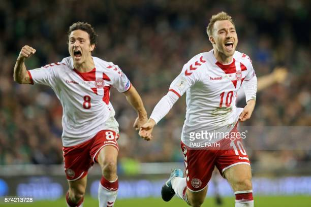 Denmark's midfielder Christian Eriksen celebrates with Denmark's midfielder Thomas Delaney after scoring their third goal during the FIFA World Cup...