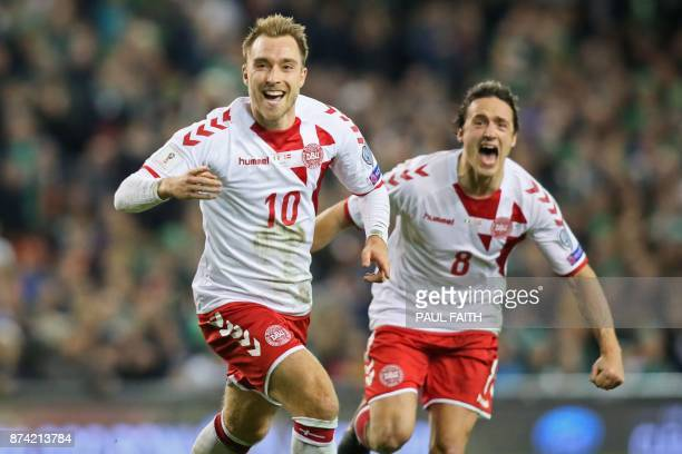 TOPSHOT Denmark's midfielder Christian Eriksen celebrates with Denmark's midfielder Thomas Delaney after scoring their third goal during the FIFA...