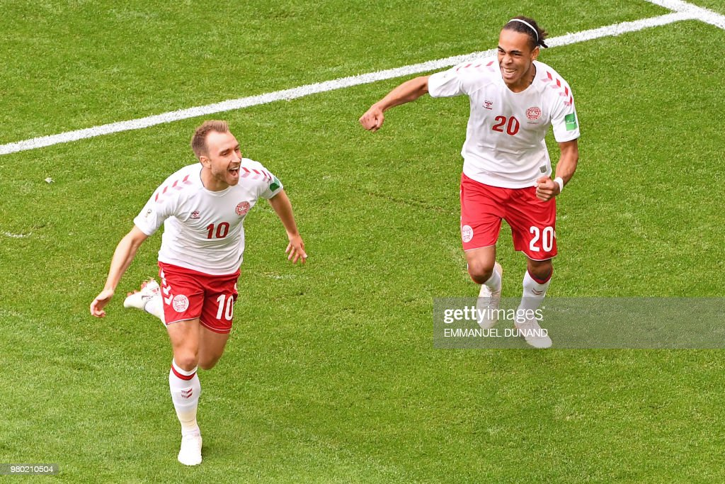 Denmark's midfielder Christian Eriksen (L) celebrates with Denmark's forward Yussuf Poulsen after scoring the opening goal during the Russia 2018 World Cup Group C football match between Denmark and Australia at the Samara Arena in Samara on June 21, 2018. (Photo by EMMANUEL DUNAND / AFP) / RESTRICTED