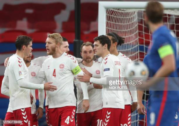 Denmark's midfielder Christian Eriksen celebrates with team-mates after scoring the opening goal from the penalty spot during the UEFA Nations League...