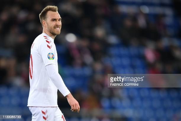Denmark's midfielder Christian Eriksen reacts during the UEFA Euro 2020 Group D qualification football match between Switzerland and Denmark at the...