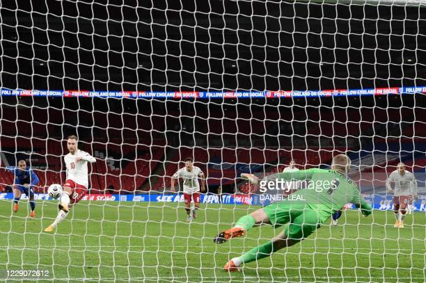 Denmark's midfielder Christian Eriksen takes a penalty and scores his team's first goal during the UEFA Nations League group A2 football match...