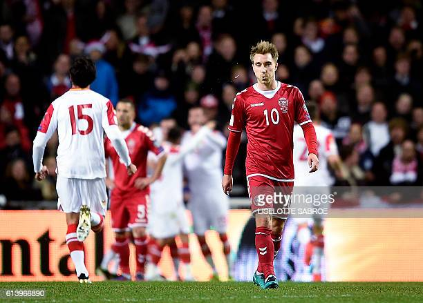 Denmark's midfielder Christian Eriksen walks on the field after Montenegro scored 10 during the WC 2018 football qualification match between Denmark...