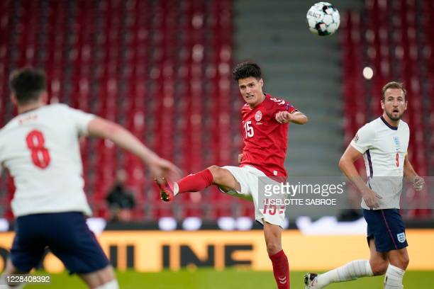 Denmark's midfielder Christian Norgaard and England's forward Harry Kane vie for the ball during the UEFA Nations League football match between...