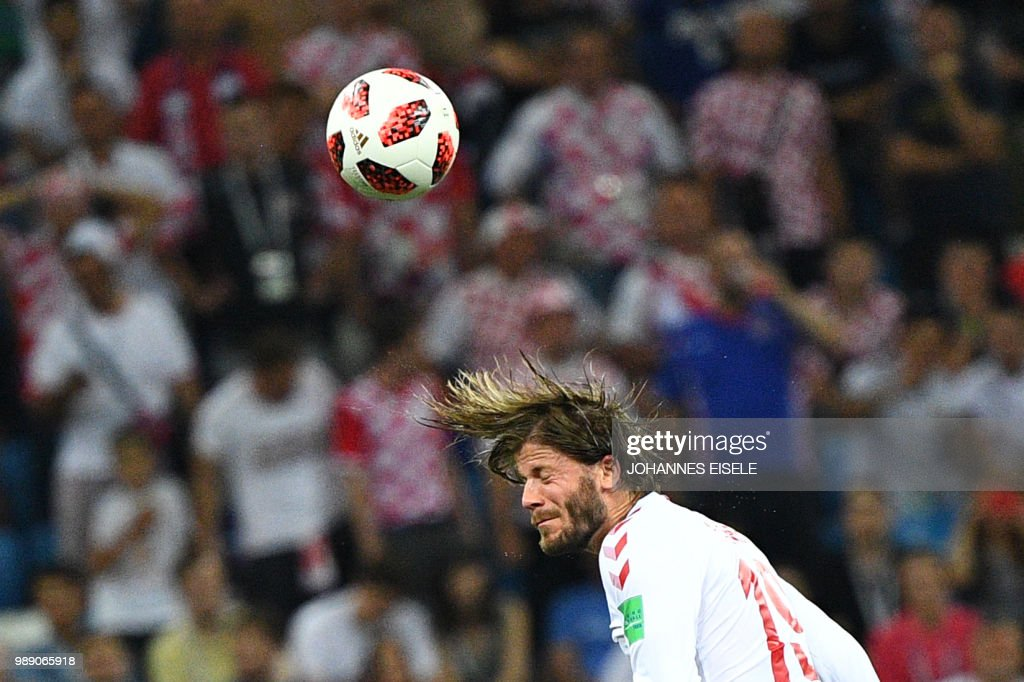 TOPSHOT - Denmark's midfielder Lasse Schone heads the ball during the Russia 2018 World Cup round of 16 football match between Croatia and Denmark at the Nizhny Novgorod Stadium in Nizhny Novgorod on July 1, 2018. (Photo by Johannes EISELE / AFP) / RESTRICTED