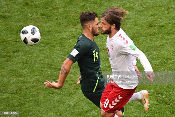TOPSHOT Denmark's midfielder Lasse Schone vies for the ball with Australia's defender Joshua Risdon during the Russia 2018 World Cup Group C football...
