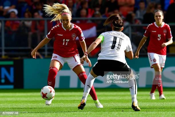 Denmark's midfielder Line Jensen vies for the ball with Austria's defender Viktoria Schnaderbeck during the UEFA Womens Euro 2017 football tournament...