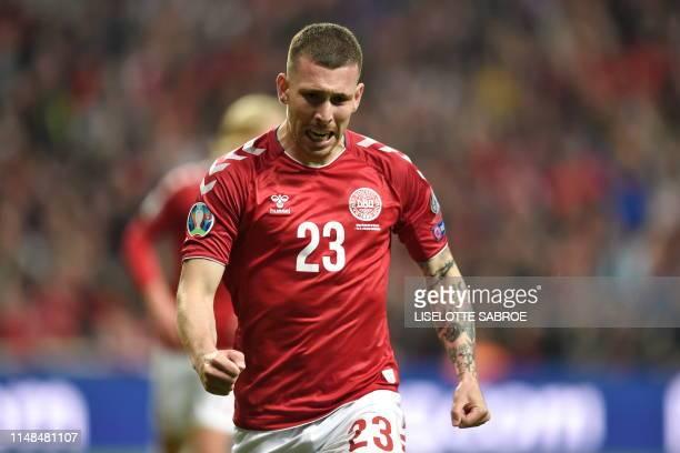 Denmark's midfielder Pierre Hojbjerg celebrates scoring during the UEFA Euro 2020 qualifier Group D football match Denmark against Ireland on June 7...