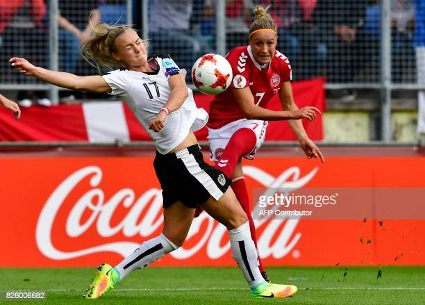 Denmark's midfielder Sanne Troelsgaard kicks the ball past Austria's midfielder Sarah Puntigam during the UEFA Womens Euro 2017 football tournament...