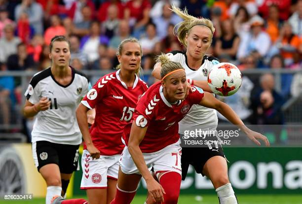 Denmark's midfielder Sanne Troelsgaard vies for the ball with Austria's midfielder Sarah Puntigam during the UEFA Womens Euro 2017 football...
