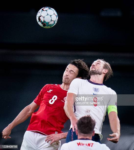 Denmark's midfielder Thomas Delaney and England's forward Harry Kane both jump to head the ball during the UEFA Nations League football match between...
