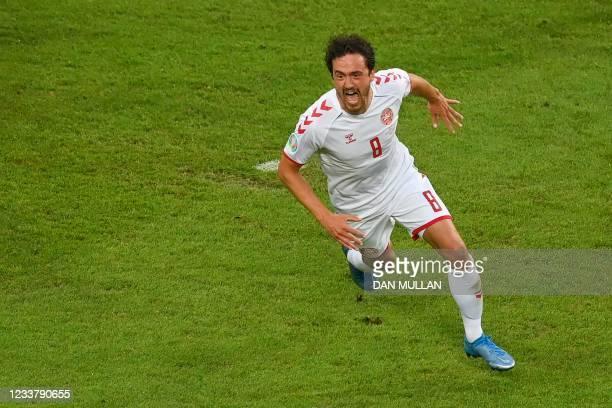 Denmark's midfielder Thomas Delaney celebrates scoring the opening goal during the UEFA EURO 2020 quarter-final football match between the Czech...