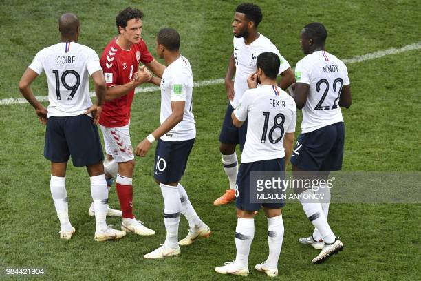 Denmark's midfielder Thomas Delaney greets France players following the Russia 2018 World Cup Group C football match between Denmark and France at...