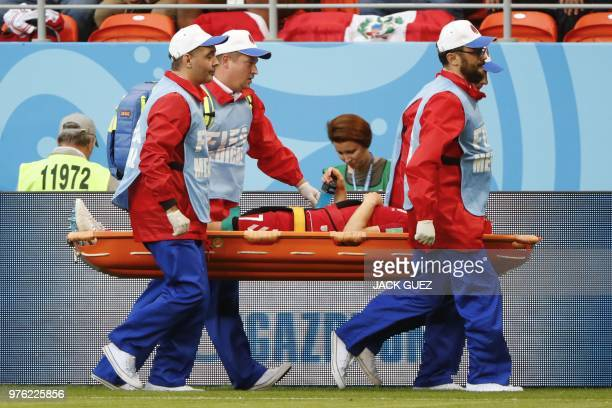 Denmark's midfielder William Kvist is evacuated from the football pitch on a stretcher after being injured during the Russia 2018 World Cup Group C...