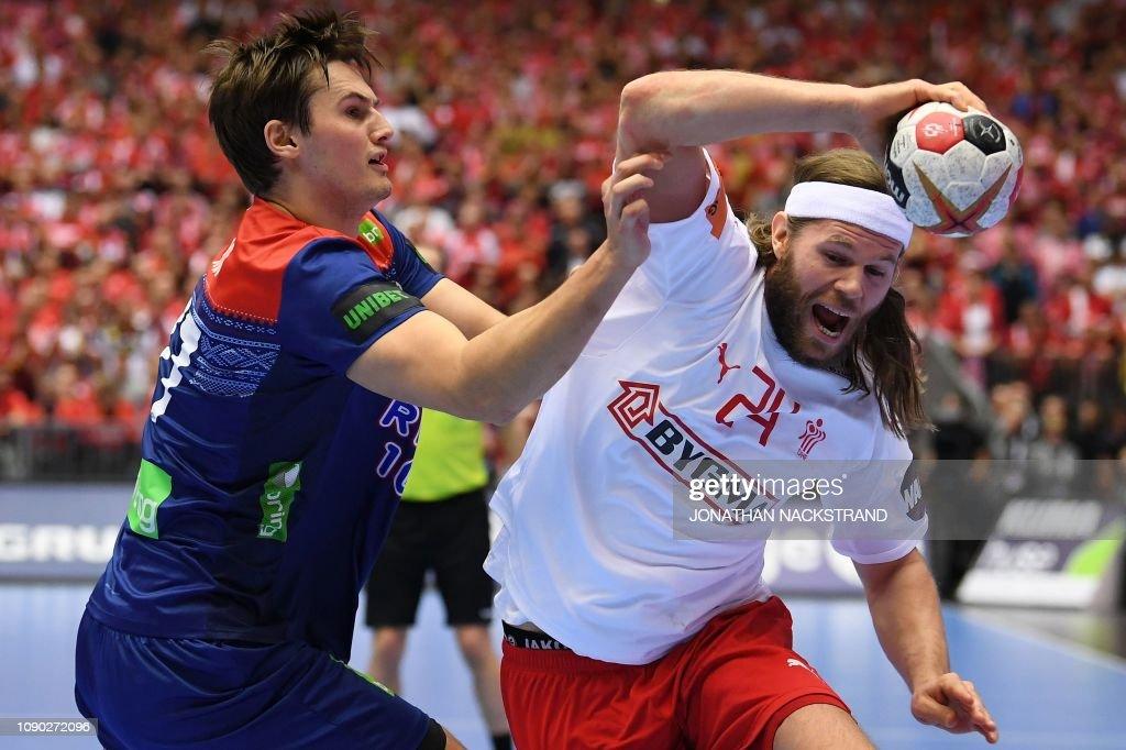 1392097ff Denmark's Mikkel Hansen and Norway's Magnus Rod vie during the IHF ...