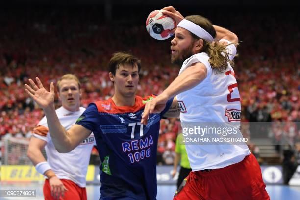 Denmark's Mikkel Hansen and Norway's Magnus Rod vie during the IHF Men's World Championship 2019 handball final match between Norway and Denmark at...