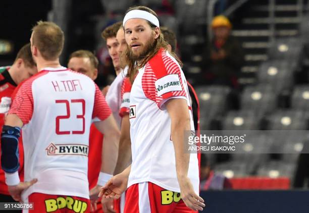 Denmark's Mikkel Hansen looks at France's players after France won the match for third place of the Men's 2018 EHF European Handball Championship...