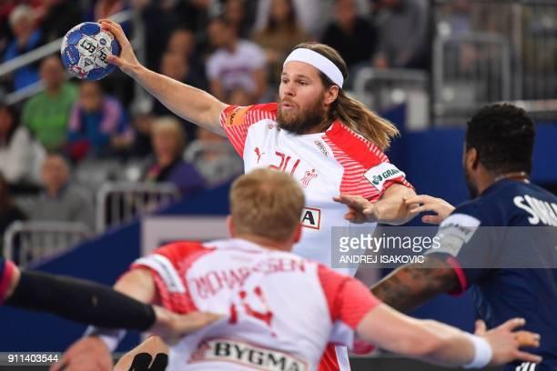 Denmark's Mikkel Hansen passes the ball during the match for third place of the Men's 2018 EHF European Handball Championship between France and...