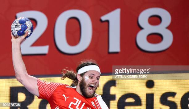Denmark's Mikkel Hansen scores a goal against Hungary during their match in the 13th edition of the EHF European Men's Handball Championship Group D...
