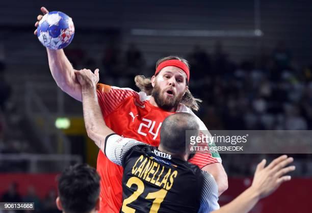 Denmark's Mikkel Hansen vies with Spain's Joan Canellas during their group 'D' match of the 13th Men's European Handball Championships Denmark versus...