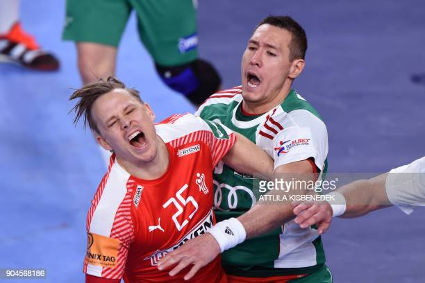 Denmark'S Morten Olsen figths with Hungary's Timuzsin Schuch during their match in the 13th edition of the EHF European Men's Handball Championship...
