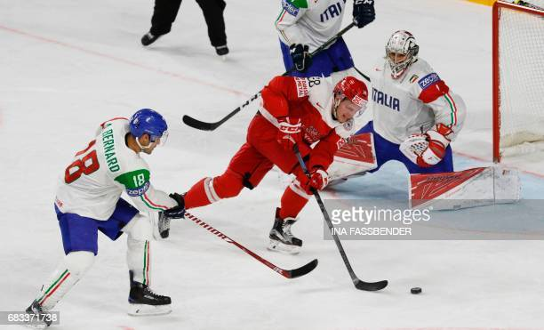 Denmark´s Morten Poulsen and Italy's Anton Bernhard vie during the IIHF Men's World Championship Ice Hockey match between Denmark and Italy in...