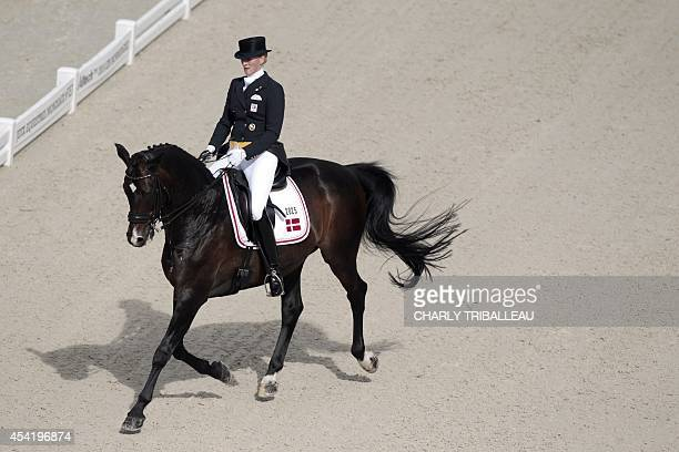 Denmark's Nathalie zu SaynWittgenstein rides Digby on August 26 2014 during the second session of the Dressage Grand Prix of the 2014 FEI World...