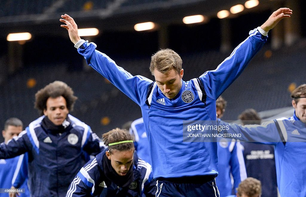 Denmark's national football team player midfielder Christian Eriksen warms up during a training session at the Friends Arena in Solna, near Stockholm on November 13, 2015 on the eve of the Euro 2016 playoff football match between Sweden and Denmark.