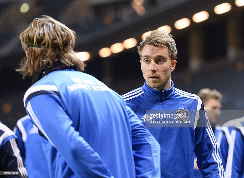 Denmark's national football team player midfielder Christian Eriksen (R) warms up during a training session at the Friends Arena in Solna, near Stockholm on November 13, 2015 on the eve of the Euro 2016 playoff football match between Sweden and Denmark.