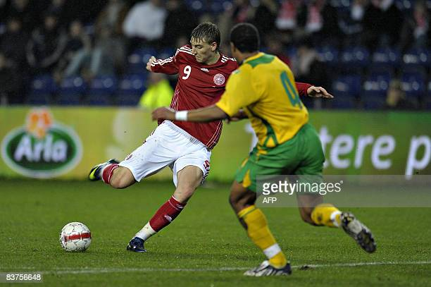 Denmark's Nicklas Bendtner and Ashley Williams of Wales vie for the ball during the friendly international soccer match in Broendby Denmark on...