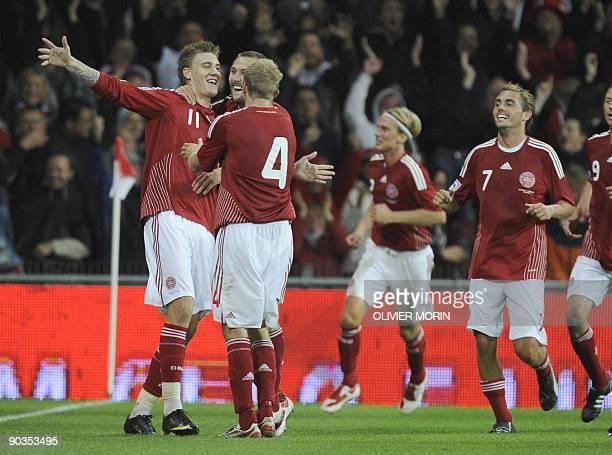 Denmark's Nicklas Bendtner celebrates after scoring during the FIFA World Cup 2010 qualifying match Denmark vs Portugal on September 5 2009 at the...