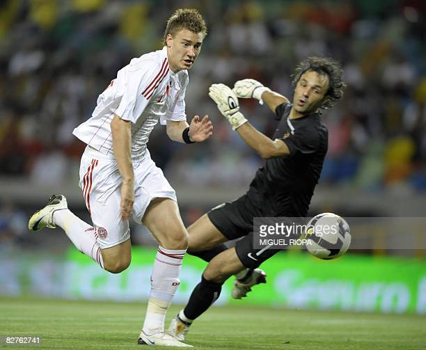 Denmark's Nicklas Bendtner tries to score a goal past Portugals goalkeeper Quim during their qualifying football match for the FIFA World Cup at the...