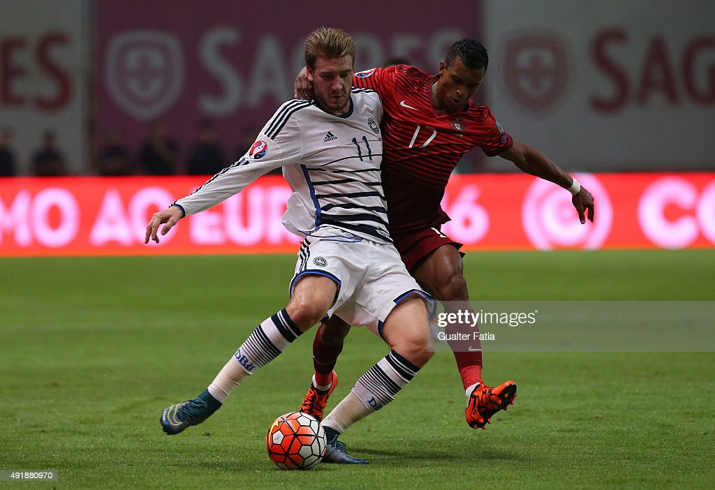 Denmark's Nicklas Bendtner with Portugal's forward Nani in action during the UEFA EURO 2016 Qualifier match between Portugal and Denmark at Estadio Municipal de Braga on October 8, 2015 in Braga Portugal.