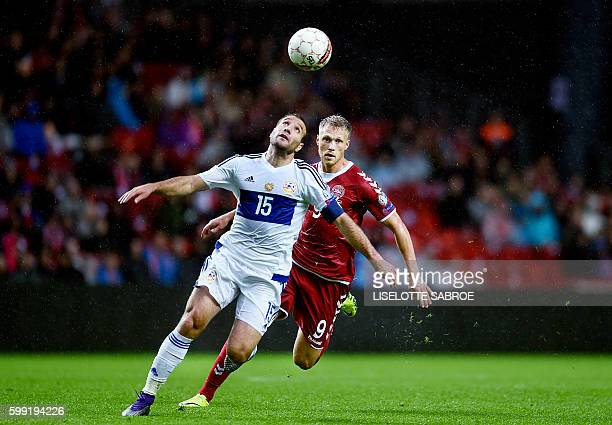 Denmark's Nicolai Jorgensen vies for the ball with Armenia's Hrayr Mkoyan during the World Cup 2018 football qualification match between Denmark and...