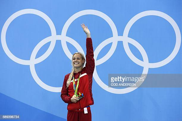 Denmark's Pernille Blume celebrates on the podium during the medal ceremony of the Women's swimming 50m Freestyle Final at the Rio 2016 Olympic Games...