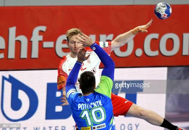 Denmark's Peter Balling Christensen vies with Slovenia's Gregor Potocnik during the group II match of the Men's 2018 EHF European Handball...